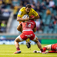 22nd May 2021; Twickenham, London, England; European Rugby Champions Cup Final, La Rochelle versus Toulouse; Geoffrey Doumayrou of La Rochelle is tackled by Cheslin Kolbe of Toulouse