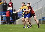 Gary Brennan of  Clare in action against Darren O Hagen of Down during their Division 2, Round 2 National League game at Cusack Park. Photograph by John Kelly.