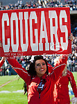 Houston Cougars cheerleaders in action during the Ticket City Bowl game between the Penn State Nittany Lions and the University of Houston Cougars, played at the Cotton Bowl Stadium in Dallas, Texas. Houston defeats Penn State 30 to 14.