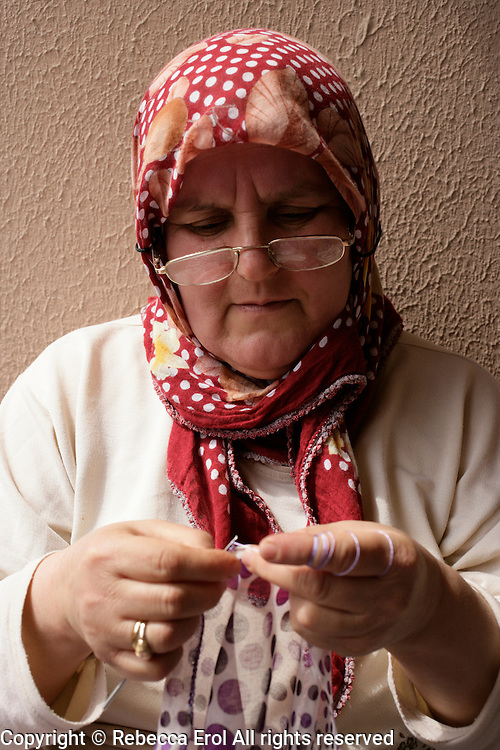 Turkish woman crocheting a headscarf edging in Istanbul, Turkey
