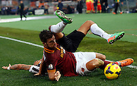 Calcio, quarti di finale di Coppa Italia: Roma vs Juventus. Roma, stadio Olimpico, 21 gennaio 2014.<br /> AS Roma midfielder Kevin Strootman, of the Netherlands, foreground, and Juventus midfielder Arturo Vidal, of Chile, fight for the ball during the Italian Cup round of eight final football match between AS Roma and Juventus, at Rome's Olympic stadium, 21 January 2014.<br /> UPDATE IMAGES PRESS/Riccardo De Luca