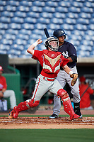 Philadelphia Phillies catcher Mitchell Edwards (19) throws to second base during a Florida Instructional League game against the New York Yankees on October 12, 2018 at Spectrum Field in Clearwater, Florida.  (Mike Janes/Four Seam Images)