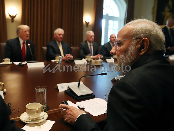 Indian Prime Minister Narendra Modi attends a meeting in the Cabinet Room with U.S. President Donald Trump and members of his cabinet at the White House June 26, 2017 in Washington, DC. Trump and Modi discussed a range of bilateral issues. Photo Credit: Mark Wilson/CNP/AdMedia