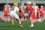 Baltimore, MD - March 3: Long stick midfielder Seth Mackin #21 of the UMBC Retrievers defends Midfielder Colin McLinden #4 of the Fairfield Stags  during the Fairfield v UMBC mens lacrosse game at UMBC Stadium on March 3, 2012 in Baltimore, MD.