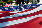 NEWTOWN, CT-1 September 2014-090114EC06--   A giant American flag, 90 x 45 feet long, also known as the Mount Rushmore flag, is carried in the Newtown Labor Day Parade Monday morning. The flag has traveled across the country and abroad. Erin Covey Republican-American
