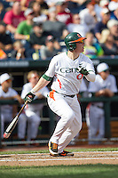 Miami Hurricanes designated hitter Zack Collins (0) follows through on his swing during the NCAA College baseball World Series against the Arkansas Razorbacks  on June 15, 2015 at TD Ameritrade Park in Omaha, Nebraska. Miami beat Arkansas 4-3. (Andrew Woolley/Four Seam Images)