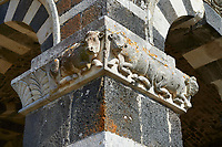 Picture and image of the Tuscan Romanesque Pisan style basilica of Santissima Trinita di Saccargia, Pillar frieze with bull, consecrated 1116, Codrongianos, Sardinia.