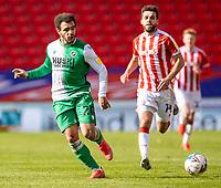 5th April 2021; Bet365 Stadium, Stoke, Staffordshire, England; English Football League Championship Football, Stoke City versus Millwall; Mason Bennett of Millwall crosses the ball