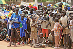 A crowd of men, women, and children gather in Rumbek's Freedom Square to attend the Africa Malaria Day festivities.  Rumbek's Africa Malaria Day 2006 was organized by the South Sudan Ministry of Health with support from the international NGO, Population Services International.