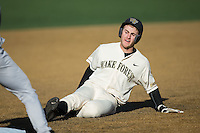 Johnny Aiello (2) of the Wake Forest Demon Deacons slides into third base against the Richmond Spiders at David F. Couch Ballpark on March 6, 2016 in Winston-Salem, North Carolina.  The Demon Deacons defeated the Spiders 17-4.  (Brian Westerholt/Four Seam Images)