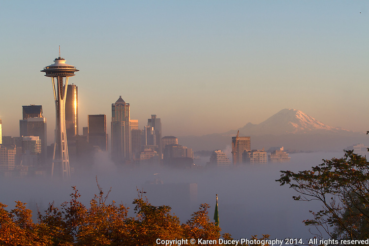 Low fog shrouds the city of Seattle with the Space Needle in the foreground.
