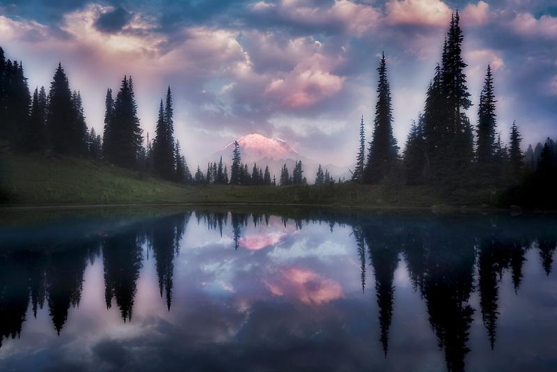 Tipsoo Lake and Mt. Rainier reflection at sunrise with fog. Mt. Rainier National Park, Washington