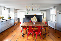 Wooden dining table with red chairs