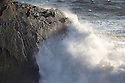 08/04/16 <br /> <br /> A man struggles to dodge giant waves at Hartland Quay, North Devon, as strong winds and high tides help to set the dramatic scene.<br /> <br /> All Rights Reserved: F Stop Press Ltd. +44(0)1335 418365   +44 (0)7765 242650 www.fstoppress.com