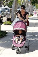 Poopy diaper? Selma Blair checks little Arthur's diapers before lifting him into the car while out and about in Los Angeles, California on 30.05.2012..Credit: Correa/face to face.. /MediaPunch Inc. ***FOR USA ONLY***