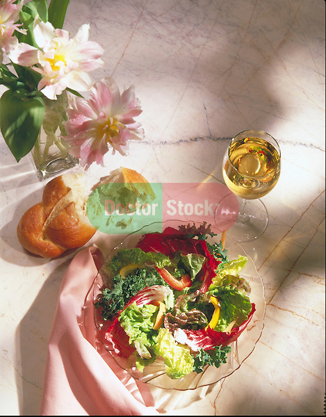 salad greens with bread and glass of wine