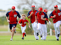 25 February 2012: Washington Nationals' first baseman Adam LaRoche's son Drake runs with the team during the first full squad Spring Training workout at the Carl Barger Baseball Complex in Viera, Florida. Mandatory Credit: Ed Wolfstein Photo