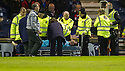 Dundee keeper Kyle Letheren is carry off after colliding with Raith Rovers' Reece Donaldson.