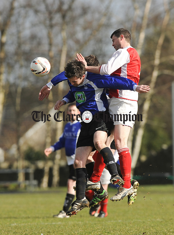 Arthur Rogers of Hermitage in action against Pat Connole of Corofin A during their Clare Cup second round game at The Fairgreen. Photograph  by John Kelly