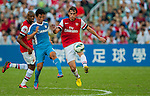 Ignasi Miquel of Arsenal FC  and Lam Ka Wa of Kitchee  in action during the pre-season Asian Tour friendly match at the Hong Kong Stadium on July 29, 2012. Photo by Victor Fraile / The Power of Sport Images
