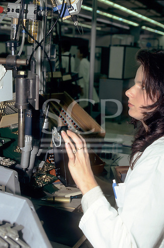Slovenia. Young female worker at an electricity meter factory.