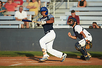 Fermin Osio (21) (UNC Asheville) of the Carolina Venom follows through on his swing against the Mooresville Spinners at Moor Park on June 22, 2020 in Mooresville, NC.  The Spinners defeated the Venom 7-2. (Brian Westerholt/Four Seam Images)