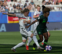 GRENOBLE, FRANCE - JUNE 22: Francisca Ordega #17 of the Nigerian National Team on the attack as Verena Schweers #17 of the German National Team defends during a game between Panama and Guyana at Stade des Alpes on June 22, 2019 in Grenoble, France.