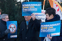 Kundgebung der CDU-Lichtenberg gegen Kommunismus.<br /> Etwa ein dutzend Mitglieder der CDU aus dem Berliner Stadtteil Lichtenberg protestierten am Samstag den 22. Januar 2011 gegen den Kommunismus. Anlass war ein umstrittener Artikel zum Thema Kommunismus der Vorsitzenden der Linkspartei Die LINKE, Gesine Loetzsch.<br /> Ungefaehr 30 Gegendemonstranten stoerten die CDU-Kundgebung mit Plakaten und Schildern.<br /> 22.1.2011, Berlin<br /> Copyright: Christian-Ditsch.de<br /> [Inhaltsveraendernde Manipulation des Fotos nur nach ausdruecklicher Genehmigung des Fotografen. Vereinbarungen ueber Abtretung von Persoenlichkeitsrechten/Model Release der abgebildeten Person/Personen liegen nicht vor. NO MODEL RELEASE! Nur fuer Redaktionelle Zwecke. Don't publish without copyright Christian-Ditsch.de, Veroeffentlichung nur mit Fotografennennung, sowie gegen Honorar, MwSt. und Beleg. Konto: I N G - D i B a, IBAN DE58500105175400192269, BIC INGDDEFFXXX, Kontakt: post@christian-ditsch.de<br /> Bei der Bearbeitung der Dateiinformationen darf die Urheberkennzeichnung in den EXIF- und  IPTC-Daten nicht entfernt werden, diese sind in digitalen Medien nach §95c UrhG rechtlich geschuetzt. Der Urhebervermerk wird gemaess §13 UrhG verlangt.]