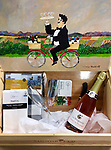 Signorello Wine Box with Painted Lid and Picnic supplies (wine not included)<br /> <br /> 8 x 12 x 21 Wooden Box<br /> <br /> When the Napa Valley experienced the devastating Atlas Fire in 2017, sadly, Signorello Winery burned. They donated their wine boxes to artists who turned them into wonderful painted pieces. This one has a flat, removable lid that Guy painted his whimsical bicycling waiter on with a fun collection for a wine country picnic.<br /> <br /> $3,000