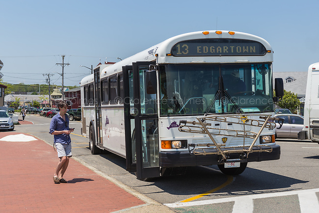 A man boards a route 13 bus as it waits to depart from Ocean Park in Oak Bluffs, Massachusetts headed for Edgartown on Martha's Vineyard.