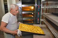 - bakery, making of a focaccia....- forno per il pane, preparazione di una focaccia