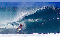 Professional surfer Andy Irons pulling into a barrel at a surf contest at Banzai Pipeline beach on the north shore of Oahu.