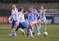 April 25, 2009 Boston Breakers vs. Chicago Red Stars--#6 Brittany Klein  of the Chicago Reds Stars pushes the ball up field against #17 Kasey Moore of  Boston Breaker .  Red Stars win the match 4-0.