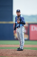 West Michigan Whitecaps relief pitcher Oswaldo Castillo (22) looks in for the sign during a game against the Quad Cities River Bandits on July 23, 2018 at Modern Woodmen Park in Davenport, Iowa.  Quad Cities defeated West Michigan 7-4.  (Mike Janes/Four Seam Images)