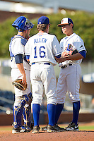 Durham Bulls pitching coach Neil Allen #16 has a discussion on the mound with pitcher Matt Moore #33 and catcher Nevin Ashley #38 during the first game of a double header against the Charlotte Knights at Durham Bulls Athletic Park on August 28, 2011 in Durham, North Carolina.   (Brian Westerholt / Four Seam Images)