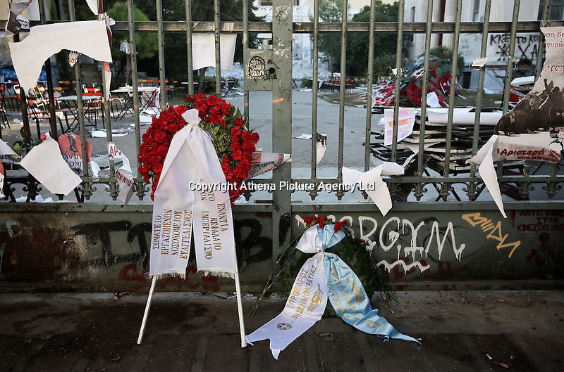 Pictured: Wreaths left at the Athens Polytechnic in Athens Greece. Thursday 17 November 2016<br /> Re: 43rd anniversary of the Athens Polytechnic uprising of 1973 which was a massive demonstration of popular rejection of the Greek military junta of 1967–1974. The uprising began on November 14, 1973, escalated to an open anti-junta revolt and ended in bloodshed in the early morning of November 17 after a series of events starting with a tank crashing through the gates of the Polytechnic.
