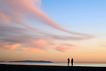 People on beach at sunset at Santa Monica with view of Palos Verdes Peninsula
