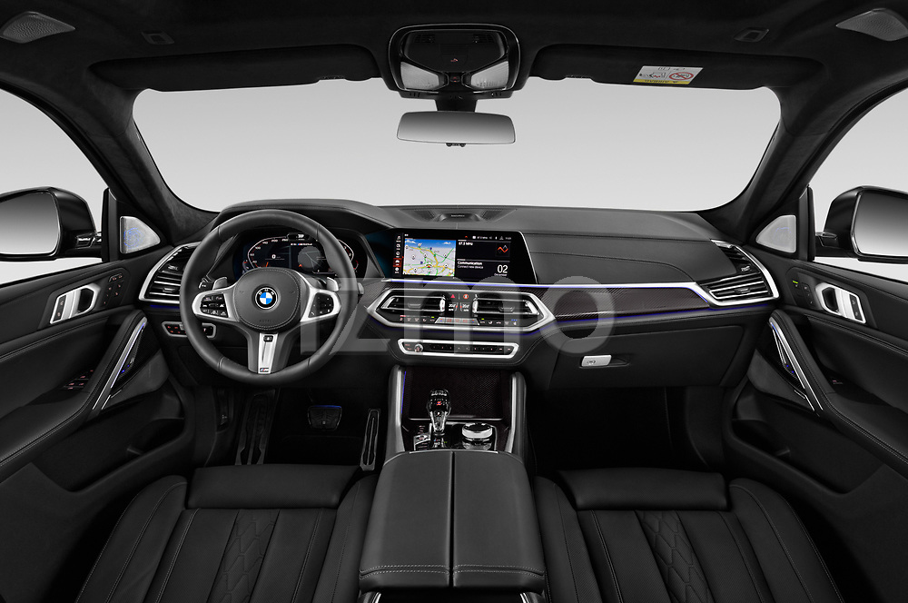 Stock photo of straight dashboard view of a 2020 BMW X6 Base 5 Door SUV