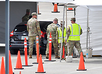 MIAMI GARDENS, FL - MARCH 22: FIRST RESPONDERS ONLY TESTING DAY - Instead of setting up for the Miami Open tennis tournament, the Florida National Guard (many without face masks due to shortage) was running a drive-through testing site off the Florida Turnpike at the Hard Rock Stadium in Miami Gardens where people can go for a COVID-19 Test Without Getting out of their Cars. As Miami-Dade County's number of COVID-19 cases rise to 169, the site will open at 9 a.m. Monday in the east parking lot of the Hard Rock Stadium, 347 Don Shula Drive. The testing is free and the site will be open from 9 a.m. to 5 p.m. on a daily basis, said Juan Diasgranados, a spokesperson for the testing site. The test site will be run and was created by several local, state and national agencies which include FEMA, the CDC, Florida Department of Health, Florida Army National Guard, Miami-Dade Police and Miami-Dade Fire Rescue on March 22, 2020 in Miami Gardens, Florida.<br /> <br /> <br /> People:  COVID-19