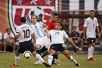 Argentina midfielder Fernando Gago (5) and United States forward Landon Donovan (10) and midfielder Pablo Mastroeni (25). The men's national teams of the United States and Argentina played to a 0-0 tie during an international friendly at Giants Stadium in East Rutherford, NJ, on June 8, 2008.