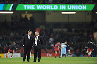Steve Hansen, New Zealand Head Coach, speaks with Ian Foster, Assistant Coach ahead of Match 23 of the Rugby World Cup 2015 between New Zealand and Georgia - 02/10/2015 - Millennium Stadium, Cardiff<br /> Mandatory Credit: Rob Munro/Stewart Communications