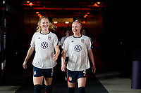 HOUSTON, TX - JUNE 13: Samantha Mewis #3 and Becky Sauerbrunn #4 of the United States exit the tunnel to warm up before a game between Jamaica and USWNT at BBVA Stadium on June 13, 2021 in Houston, Texas.