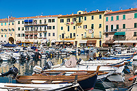 Fishing boats in harbor, Portoferraio, Elba, Italy.