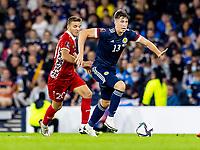 4th September 2021; Hampden Park, Glasgow, Scotland: FIFA World Cup 2022 qualification football, Scotland versus Moldova: Jack Hendry of Scotland breaks away from Sergiu Platica of Moldova