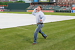 2011 Kentucky Derby winning trainer H. Graham Motion throws out the first pitch at Camden Yards in Baltimore.