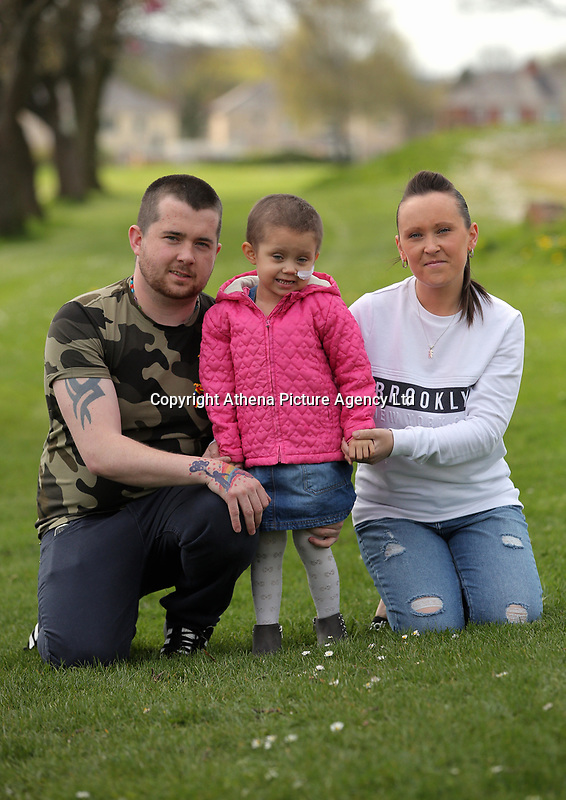 """COPY BY TOM BEDFORD<br /> Pictured: Mia Chambers (C) with dad Josh (L) mum Kirsty (R) <br /> Re: One of Britain's poorest towns is raising £100,000 to send a little girl to America because the lifesaving drugs she needs are not available on the NHS.<br /> Brave Mia Chambers, five, is in remission after having an ovary and kidney removed due to neuroblastoma, a rare and aggressive type of cancer.<br /> Doctors have told her parents Josh and Kirsty there is a 50 per cent chance of the cancer returning without the specialist drugs.<br /> Josh, 28, said: """"That's not a chance we are prepared to take - the odds are too high.<br /> """"We researched it on the internet and found children in the US are beating this terrible illness.<br /> """"Doctors there are willing to treat her but it will cost more money than we have.""""<br /> The couple's plight has touched the hearts of people in their home town of Merthyr Tydfil, South Wales, and money has begun pouring in.         <br /> Mia had chemotherapy on the Rainbow ward at the Noah's Ark Children's Hospital for Wales where nurses nicknamed her the Rainbow Warrior because of her fighting spirit."""