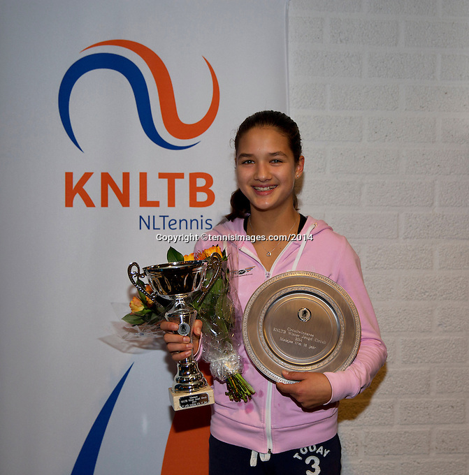 November 30, 2014, Almere, Tennis, Winter Youth Circuit, WJC,  Prizegiving, Girls 16 years, Merel Hoedt, First masters and overall winner.<br /> Photo: Henk Koster