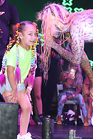 MIAMI, FL -MAY 1: 6ix9ine with fan at Trillerfest Miami at Miami Marine Stadium on May 1, 2021. Credit: Walik Goshorn/MediaPunch