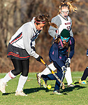 LITCHFIELD, CT-111820JS06 Wamogo's Abby Lutz (4) and Shepaug's Grace Crispino (6) battle for the ball during their field hockey game Wednesday at Wamogo High School. <br />  Jim Shannon Republican-American