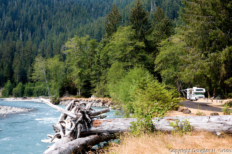 Private campsites, great hiking, and the Olympic National Park Visitor Center make the Hoh River Campground the best in the park.  The powerful Hoh River charges down from the high Olympic Mountains. Olympic National Park.  Olympic Penninsula, Washington.  Outdoor Adventure. Olympic Peninsula
